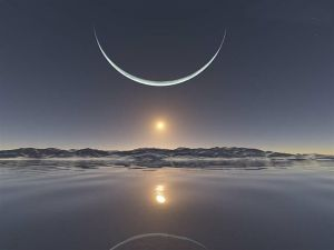 Sunset at the North Pole with the moon at its closest point.